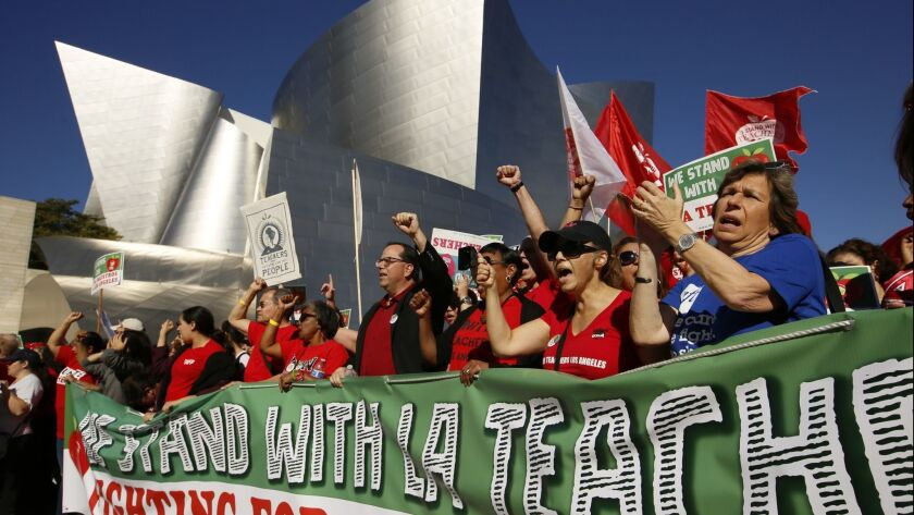 United Teachers Los Angeles leaders are joined by thousands of teachers, who may go on strike agains