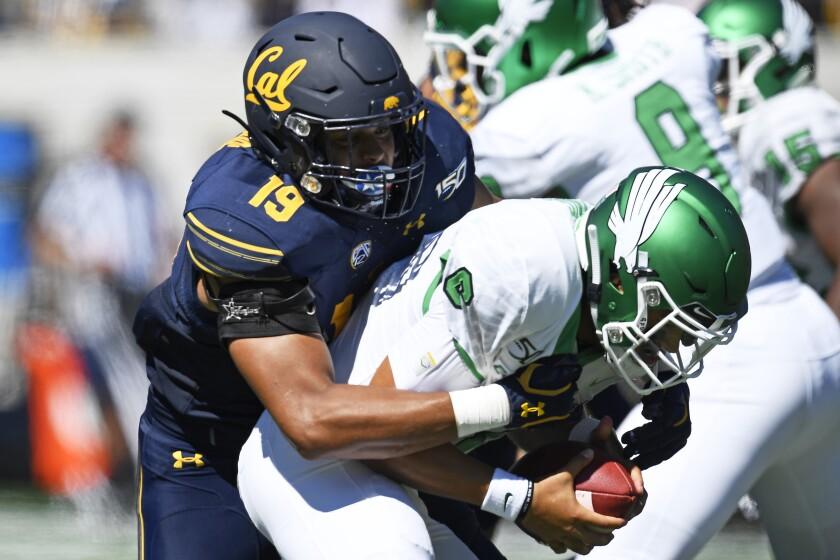 California Cameron Goode (19) sacks North Texas quarterback Mason Fine (6) during the first half of an NCAA college football game at Memorial Stadium in Berkeley, Calif., on Saturday, Sept. 14, 2019. (Jose Carlos Fajardo/San Jose Mercury News via AP)