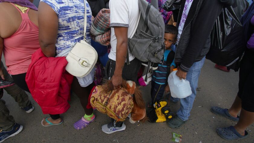 Migrants arrive from Mexicali to Tijuana. The group first went to the Benito Juarez Sports Complex which was originally used as the temporary shelter.