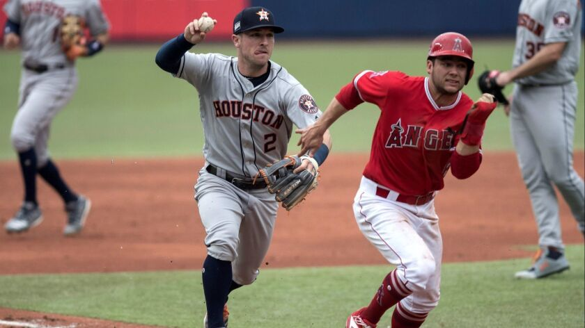 Houston Astros third baseman Alex Bregman chases David Fletcher during a rundown in the third inning of the Angels' 10-4 loss at Monterrey, Mexico.