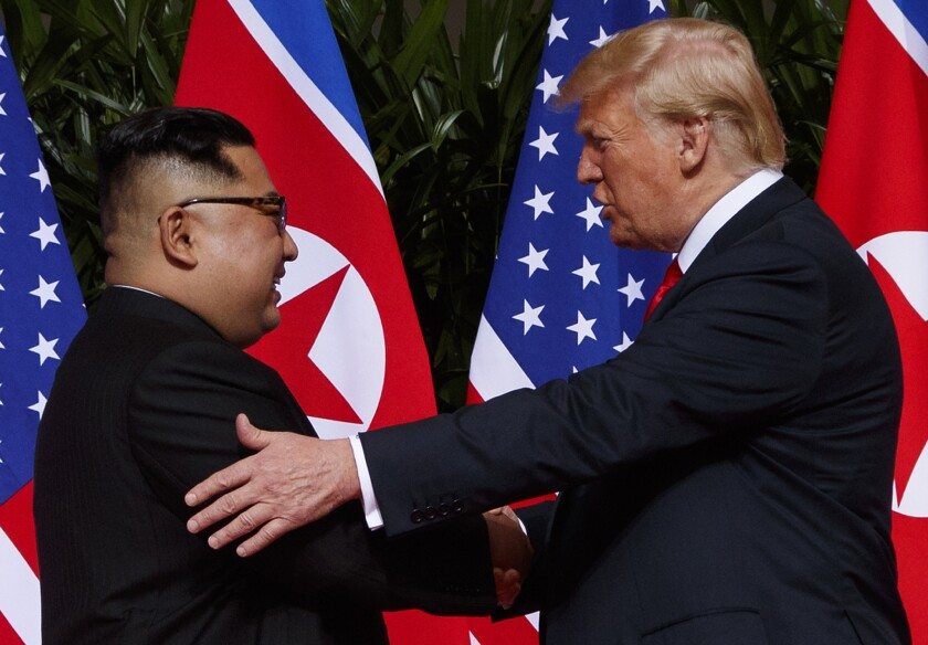 U.S. President Donald Trump meets with North Korean leader Kim Jong Un on Sentosa Island in Singapore on June 12, 2018.