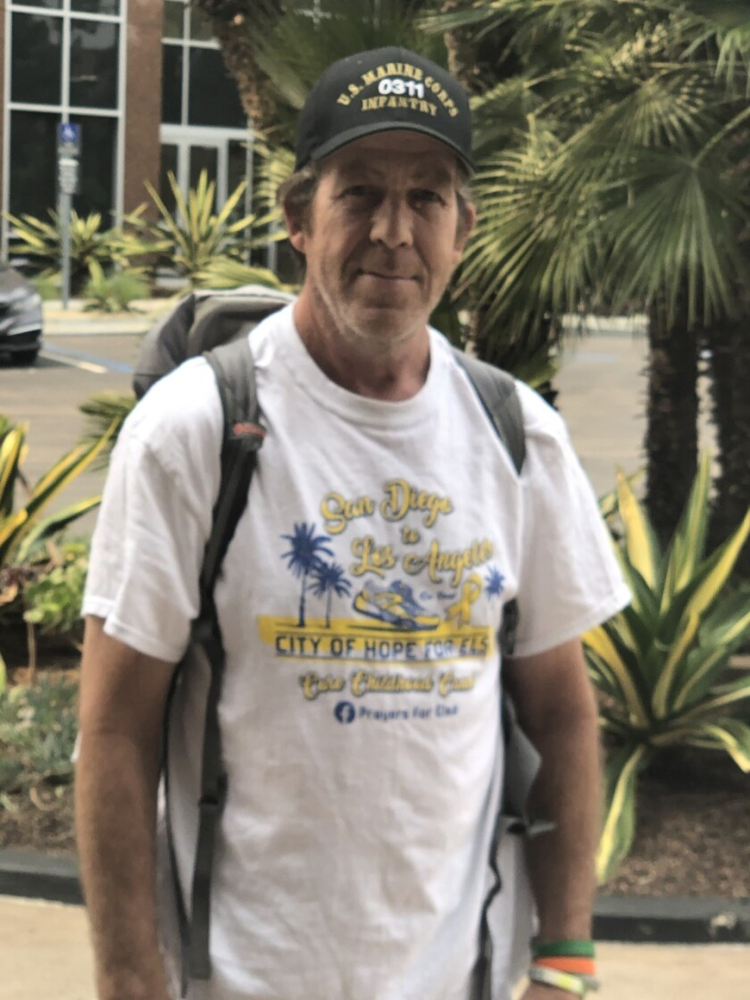 Jim Hickey, a Marine veteran, is walking from downtown San Diego to L.A. to help a girl fighting cancer
