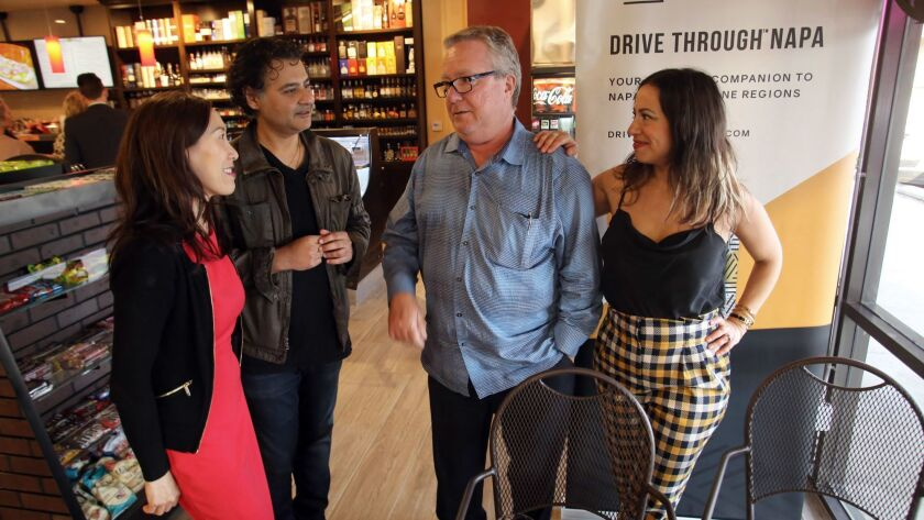 Julie Lim , the proprietor of OC Wine Mart & Deli, left, Nashad Huda, the publisher of Drive Through