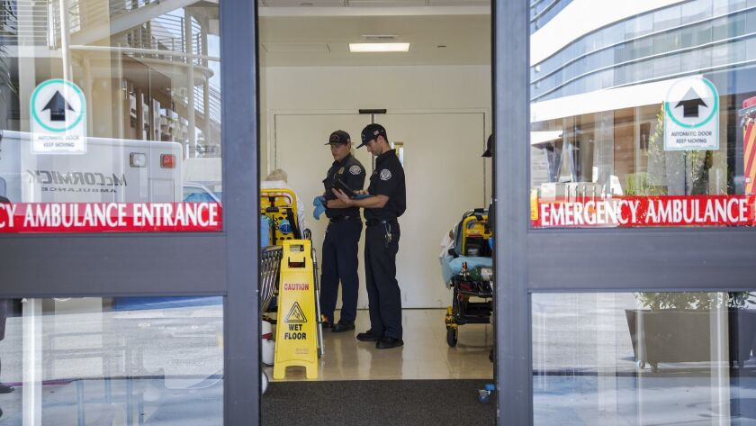 Paramedics tend to a patient inside the Emergency Room at Torrance Memorial Medical Center on January 11 in Torrance, California.