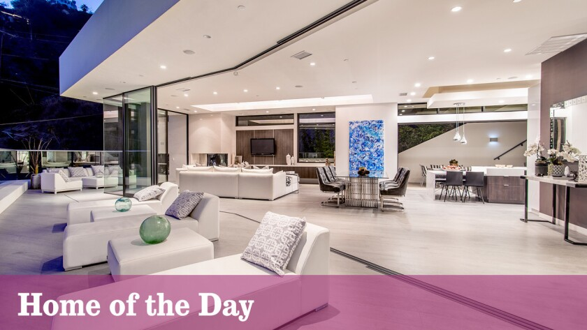 Sliding walls of glass blend indoor-outdoor spaces at this three-story contemporary set above the Sunset Strip.