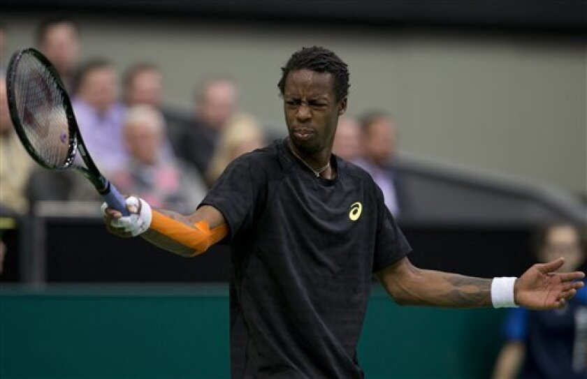 Gael Monfils of France grimaces after missing a shot against Juan Martin del Potro of Argentina at the ABN AMRO world tennis tournament at Ahoy Arena in Rotterdam, Netherlands, Tuesday Feb. 12, 2013. Del Potro won in two sets, 6-3, 6-4. (AP Photo/Peter Dejong)