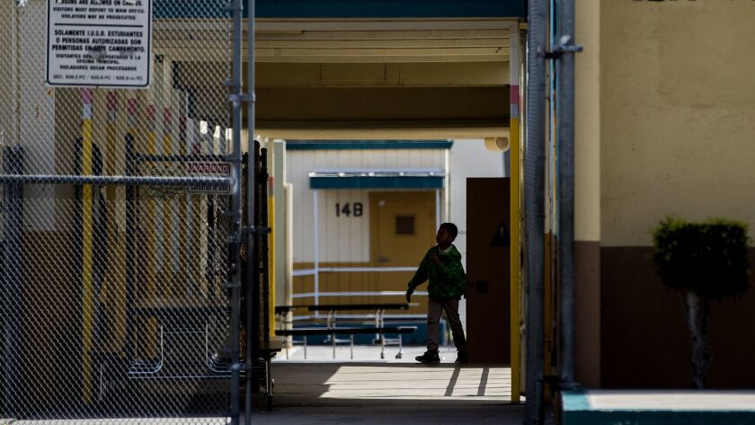 INGLEWOOD, CA - APRIL 5, 2018: A student walks between classrooms at the end of the school day at C