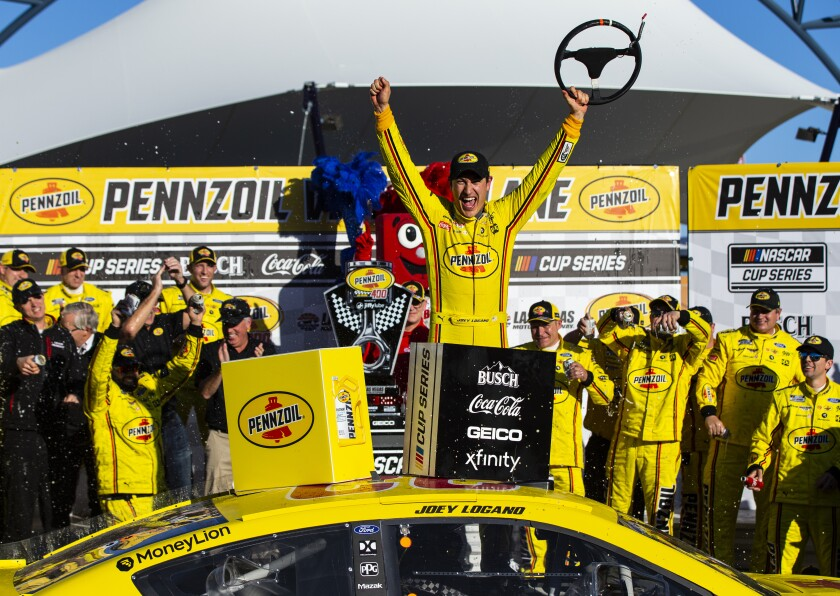 Joey Logano celebrates after winning a NASCAR Cup race at Las Vegas Motor Speedway on Sunday.