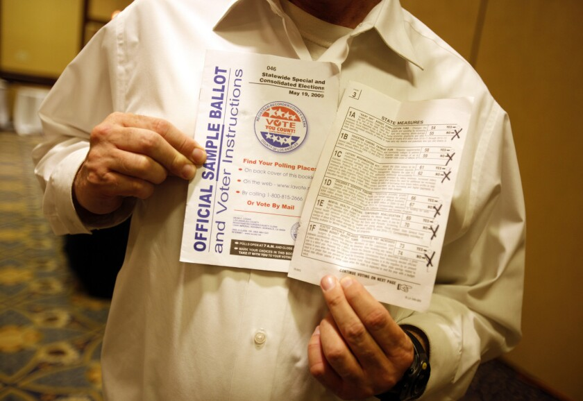 "A voter shows off his sample ballot with ""no"" checked on all the measures after a statewide special election in California on May 19, 2009."