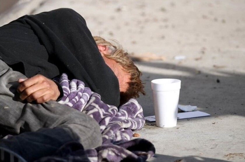 A picture of a homeless man sleeping in Costa Mesa in January 2019.