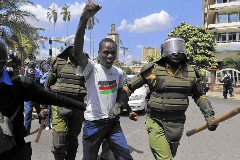 Kenyan police arrest a demonstrator Dec. 18 who was protesting an anti-terrorism law that places restrictions on journalists and broadly targets Somali refugees.