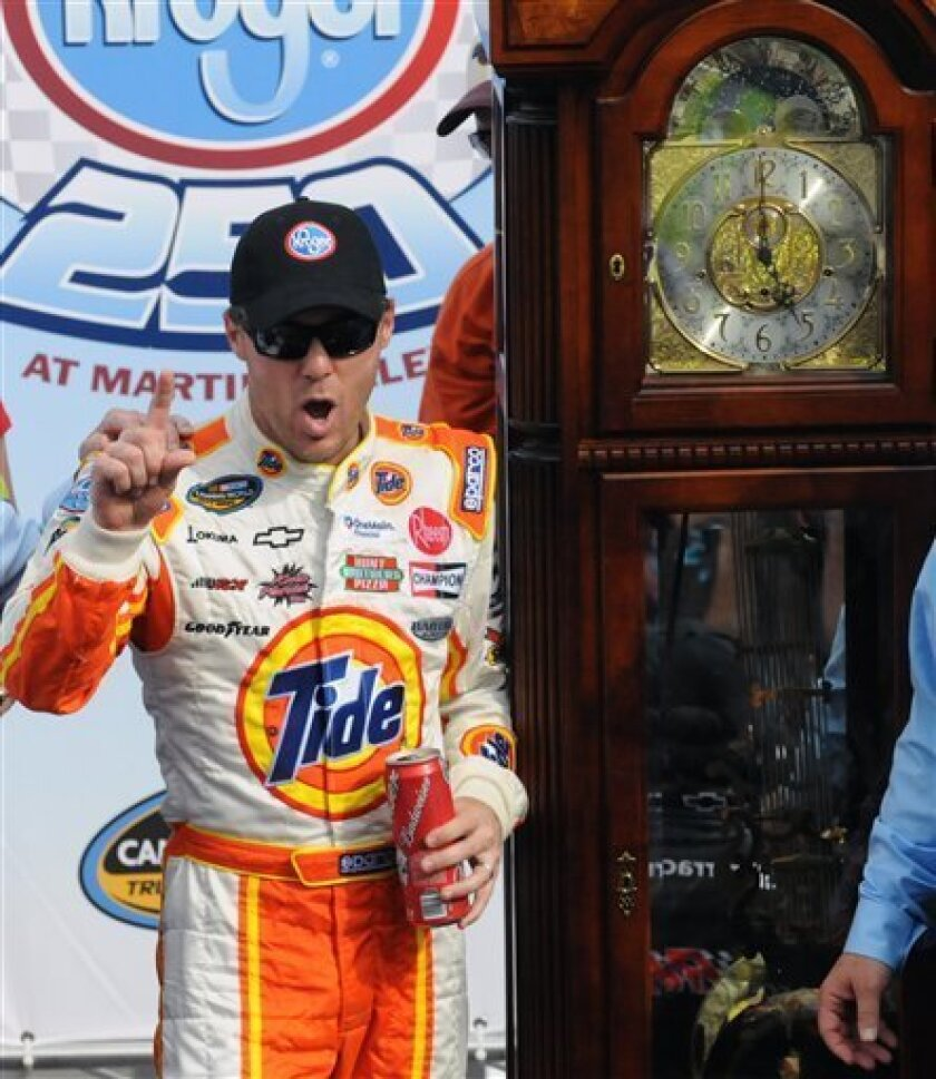 Kevin Harvick celebrates after winning the NASCAR Truck Series auto racing at Martinsville Speedway, Saturday March 31, 2012, in Martinsville, Va. (AP Photo/Don Petersen)