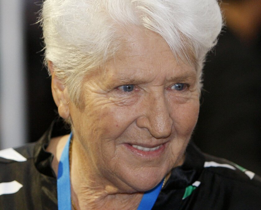 """FILE - In this Tuesday, Nov. 18, 2008 photo, former Australian swimmer Dawn Fraser walks the red carpet during the world premier of """"Australia"""", in Sydney. Fraser will return to Japan this week to celebrate the 50th anniversary of the Tokyo Olympics, where she won fame in the pool and notoriety outside the arena. Fraser won the 100-meter freestyle in the Tokyo Olympics in 1964. (AP Photo/Mark Baker)"""
