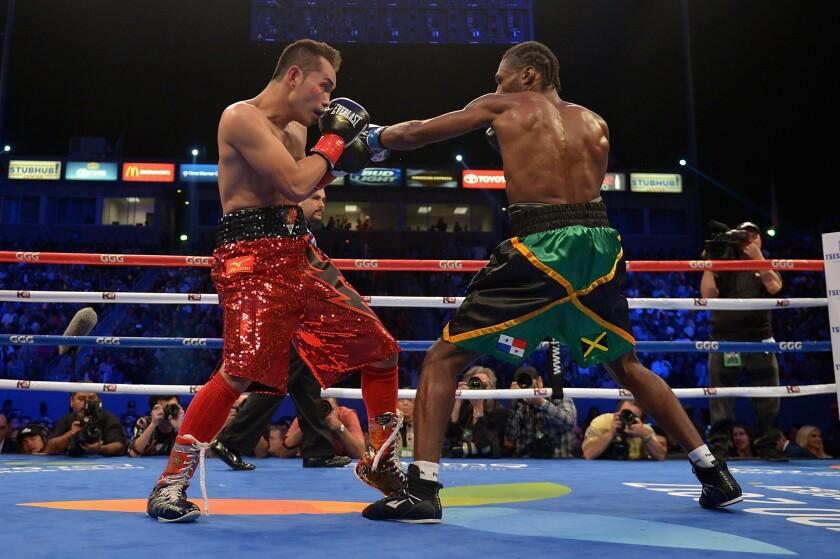 Nonito Donaire, left, fights Nicholas Walters at StubHub Center in 2014. The Filipino Donaire will face Jessie Magdaleno Nov. 5 in Las Vegas.