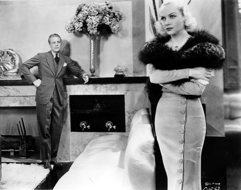 "Gene Raymond and Carole Lombard in ""Brief Moment."""