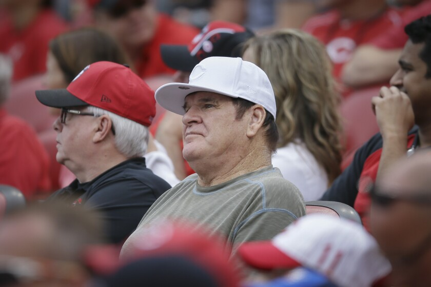 Former Cincinnati player and manager Pete Rose watches a baseball game between the Reds and Washington Nationals on May 31. A new report indicates Major League Baseball's all-time hits leader bet on Reds games while he was still a player for the team.