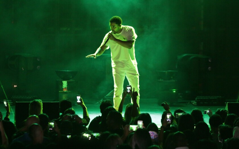 Review: Drake and Lil Wayne square off, sort of, at the