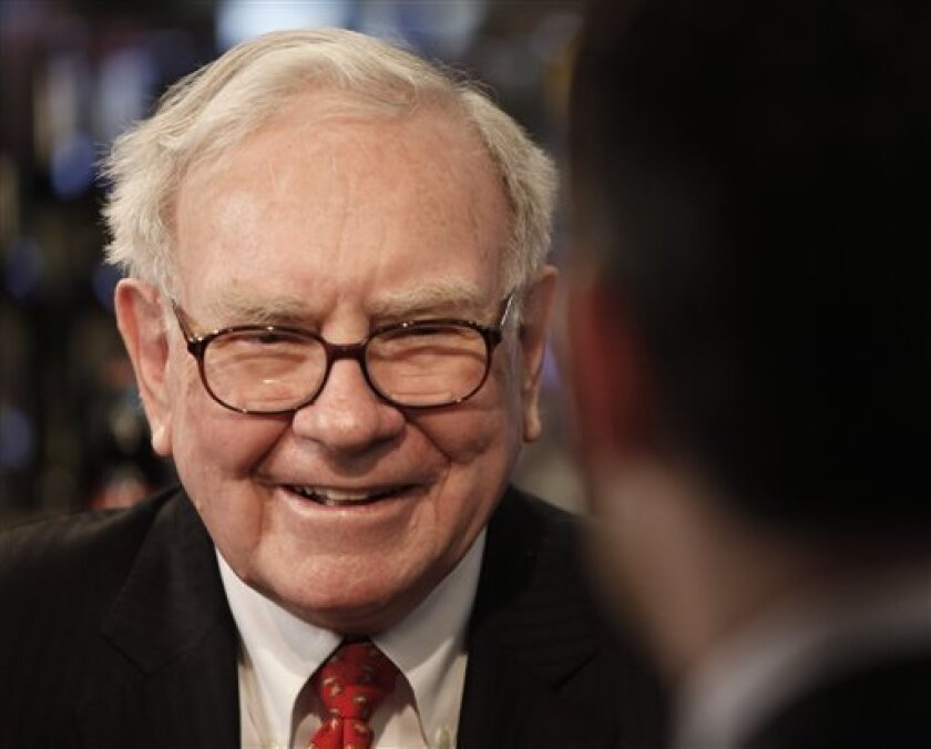 FILE - In this Feb. 22, 2010 file photo, Berkshire Hathaway Chairman and CEO Warren Buffett is interviewed before lunch with officials from Salida Capital, at Smith and Wollensky in New York.  (AP Photo/Seth Wenig, file)