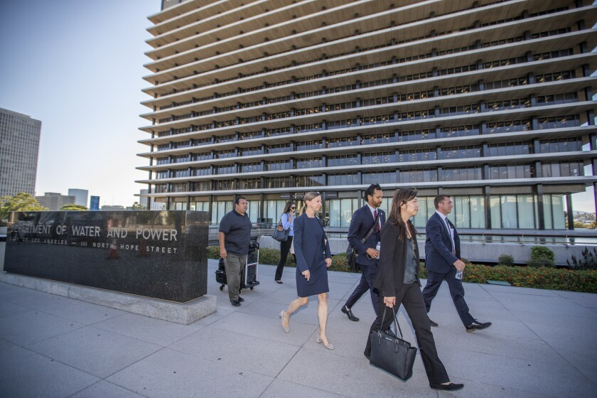 FBI agents leave the downtown headquarters of the Los Angeles Department of Water and Power