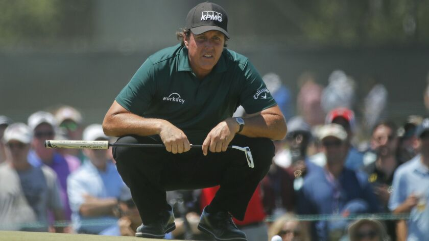 Phil Mickelson lines up a shot on the fourth green during the third round of the U.S. Open Golf Championship, Saturday, June 16, 2018, in Southampton, N.Y.