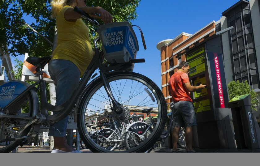 Carey Bisonet and his wife Meghan checked out two bikes from the DecoBike San Diego station on Market Street and 7th Avenue in downtown San Diego.