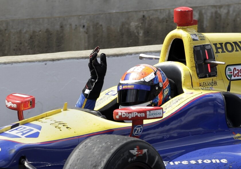 Alexander Rossi celebrates as he drives to Victory Lane after winning the 100th running of the Indianapolis 500 auto race at Indianapolis Motor Speedway in Indianapolis, Sunday, May 29, 2016. (AP Photo/Michael Conroy)