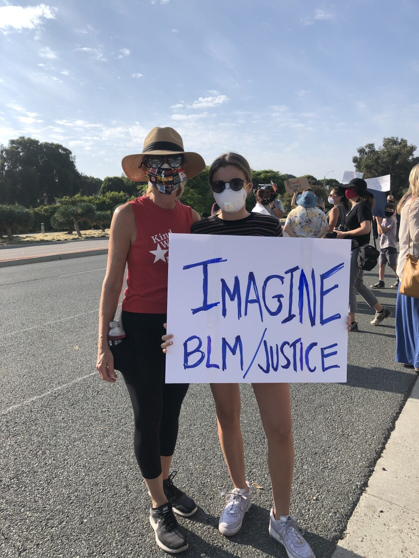 Mia Mosebrook (right) with her mother, April, at a rally for racial equality.