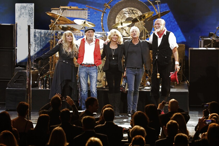 Fleetwood Mac members take their bows at a MusiCares tribute, which honored the band in January 2018.