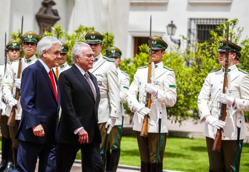 Chilean President Sebastian Piñera (L) and his Brazilian counterpart, Michel Temer (R), attend the signing of a bilateral free-trade agreement at La Moneda Palace in Santiago, Chile, on Nov. 21, 2018. EPA-EFE/ALBERTO PENA
