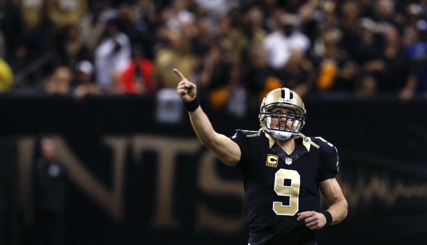 New Orleans Saints quarterback Drew Brees (9) reacts in the second half of an NFL football game against the New York Giants in New Orleans, Sunday, Nov. 1, 2015. Brees tied an NFL record for the most touchdown passes in a single game. The Saints won 52-49. (AP Photo/Jonathan Bachman)