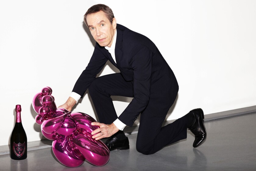 """Pop artist and sculptor Jeff Koons with the limited edition """"The Balloon Venus for Dom Pérignon,"""" which houses a bottle of the newly released 2003 Rose."""
