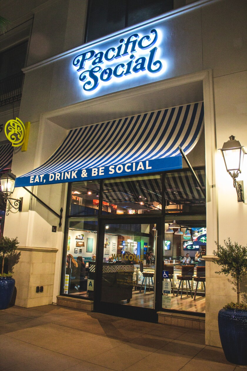The new colorful logo awnings at Pacific Social, which Cohn Restaurant Group unveiled in Carmel Valley on Thursday evening.