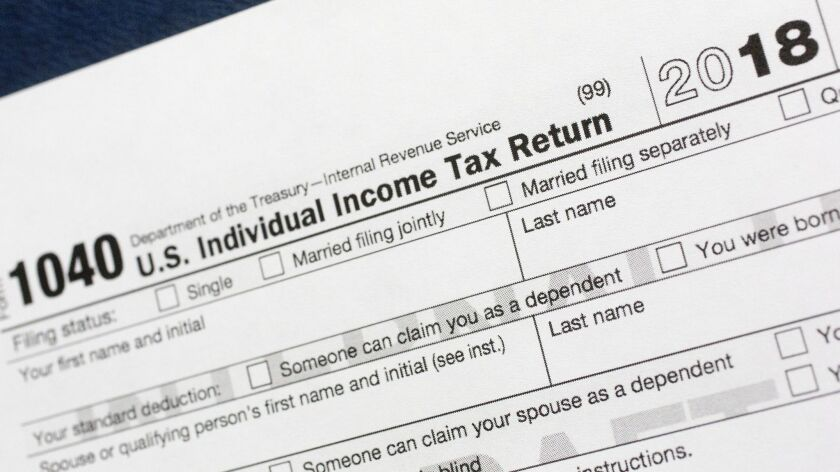 FILE - This July 24, 2018, file photo shows a portion of the 1040 U.S. Individual Income Tax Return
