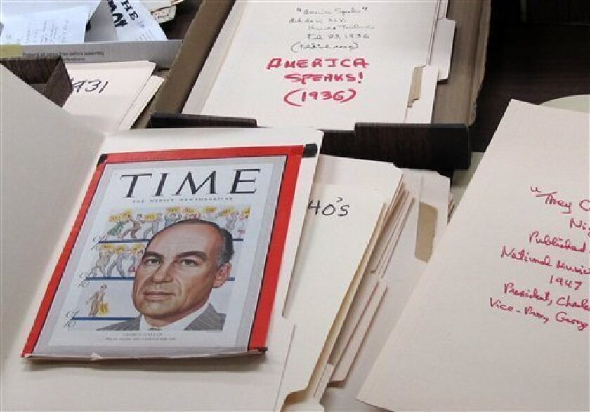 This Dec. 11, 2012 photo shows a 1948 cover of Time Magazine featuring the late George Gallup Sr., the founder of the Gallup Poll, at the University of Iowa library in Iowa City, Iowa. Gallup's grandchildren recently donated more than 200 boxes of papers that document the career of Gallup, who is considered the father of modern political polling. (AP Photo/Ryan J. Foley)