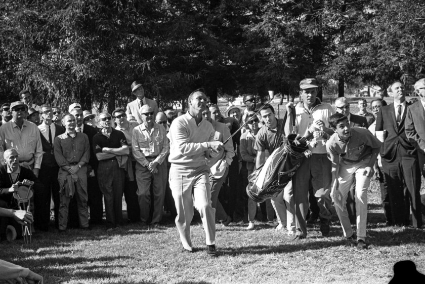 Jan. 3, 1964: Arnold Palmer and his fans follow flight of ball during L.A. Open golf tournament. Pal