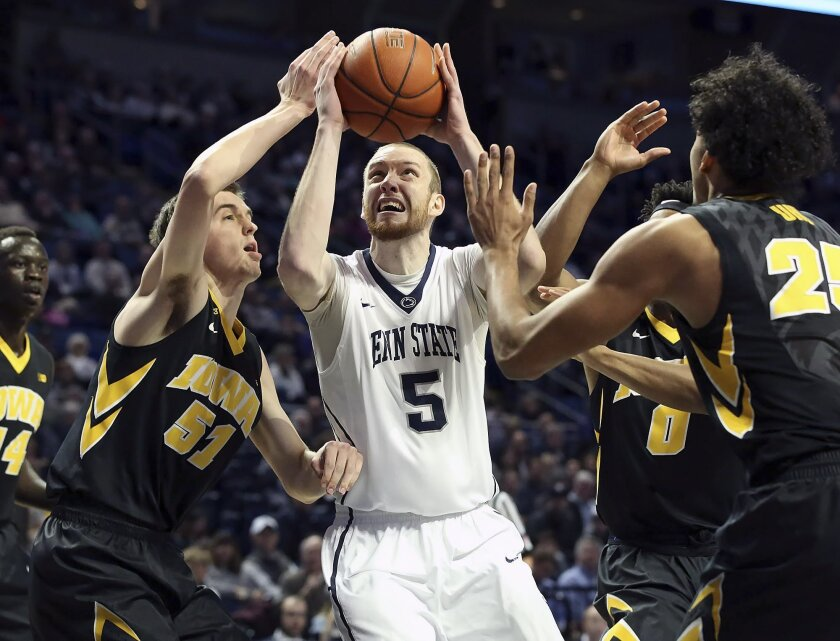 Penn State forward Donovan Jack (5) drives to the basket as Iowa forward Nicholas Baer (51) defends during the first half of an NCAA college basketball game, Wednesday, Feb. 17, 2016, in State College, Pa. (AP Photo/Chris Knight)