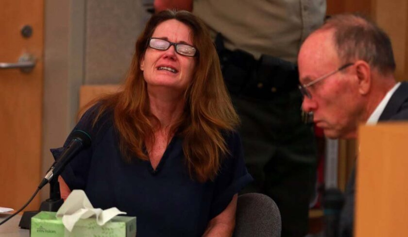 Katherine Heinzel, 51, of Winchester, a retired Newport Beach police officer and DUI crime scene investigator, reacted as she was sentenced Friday in Vista for having killed a young Perris, Ca. man in 2011 when, under the influence of alcohol, struck the car he was driving on I-15. Two other young