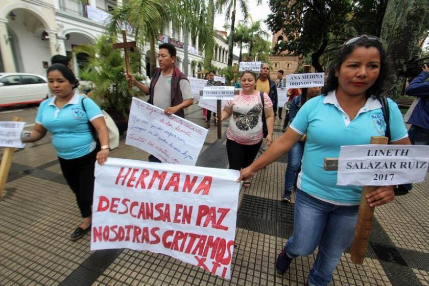 Relatives and friends of victims of violence against women, together with activists for women's rights, participate in a rally to demand justice against sexist violence, in Santa Cruz, Bolivia, 23 November 2018. EPA-EFE/ Juan Carlos Torrejón