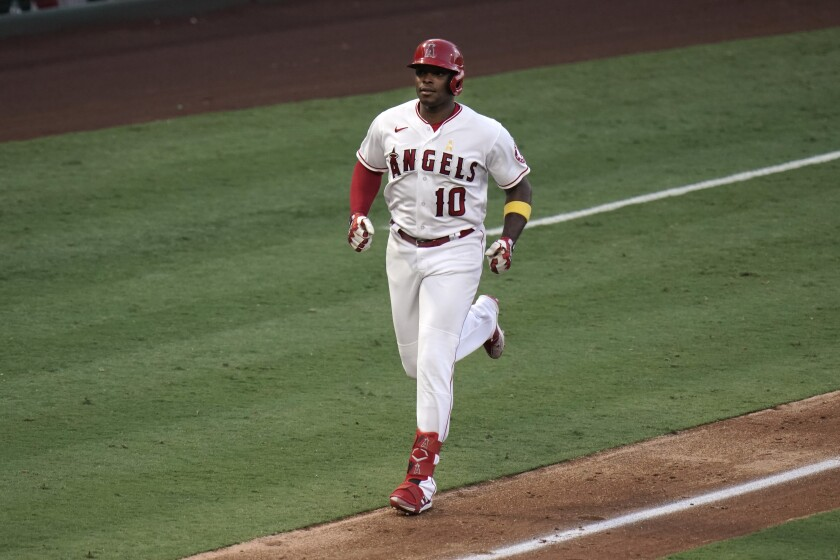 Angels' Justin Upton runs toward home after hitting a two-run home run.