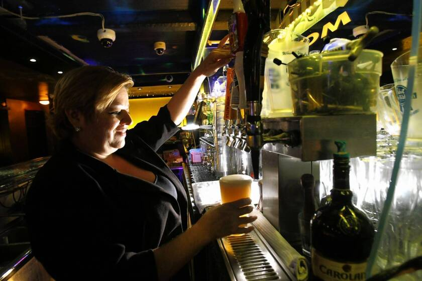 A bartender pours a Pabst Blue Ribbon beer. The popular beverage is going up in price, as are other cheaper beers as brewers try to keep customers from switching away from their more-expensive products