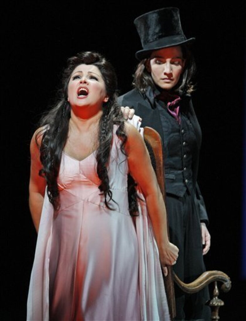 """FILE - Anna Netrebko, as the young singer Antonia, performs with Kate Lindsey, as Nicklausse, the Muse of Poetry, during a dress rehearsal for the Metropolitan Opera's production of """"Les Contes d'Hoffmann"""" (Tales of Hoffmann) in New York, Monday, Nov. 30, 2009. If you haven't gone to a movie, jazz concert or an art exhibit in recent years, you are in steadily growing company. A new study from the National Endowment for the Arts finds a notable decline in theater, museum and concert attendance and other """"benchmark"""" cultural activities between 2002 and 2008 for adults 18 and older, and a sharper fall from 25 years ago. The drop was for virtually all art forms and for virtually all age groups and levels of education. (AP Photo/Kathy Willens)"""