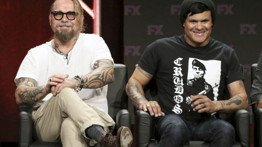 """Kurt Sutter, co-creator/executive producer/writer, left, and Elgin James, co-creator/executive producer/writer/director, participate in the """"Mayans M.C."""" panel during the FX Television Critics Association Summer Press Tour."""