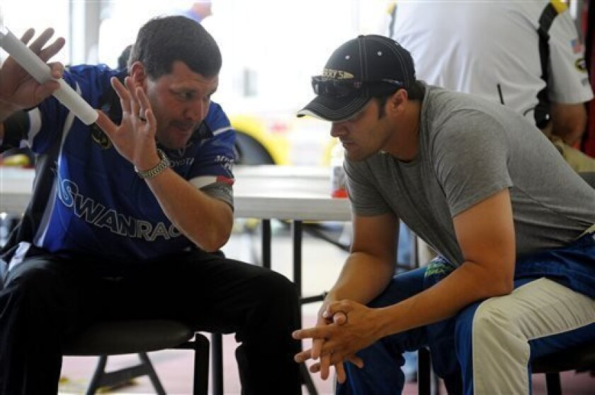 Driver David Stremme, right, gets pointers from crew chief Steven Lane in the garage area before practice for Sunday's NASCAR Sprint Cup Series auto race at Atlanta Motor Speedway, Saturday, Aug. 31, 2013 in Hampton, Ga. (AP Photo/David Tulis)