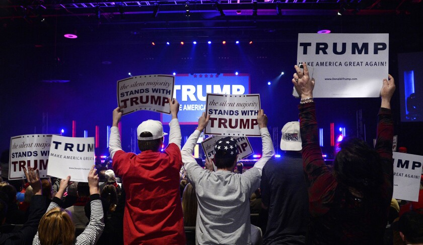 Donald Trump supporters cheer during a campaign rally in Greenville, S.C., on Monday.