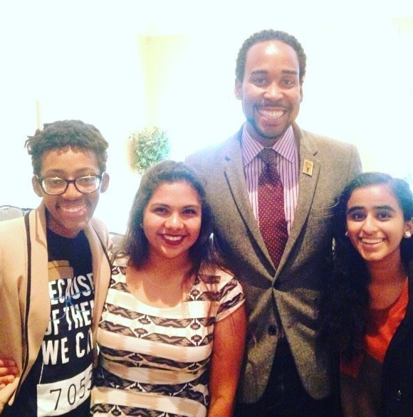 WIT teens Melanie Gonzalez and Manali Joshi at the University of Virginia Youth of Color Matter conference with David Johns, executive director of the White House Commission on Educational Excellence for African Americans and grad fellow Lauren Mims. Courtesy photo