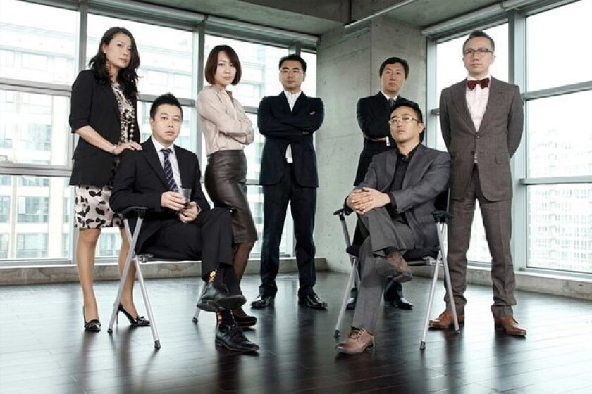"""Employees of Ogilvy & Mather Advertising in Beijing dressed up for a """"Mad Men"""" party held on November 4, 2011."""