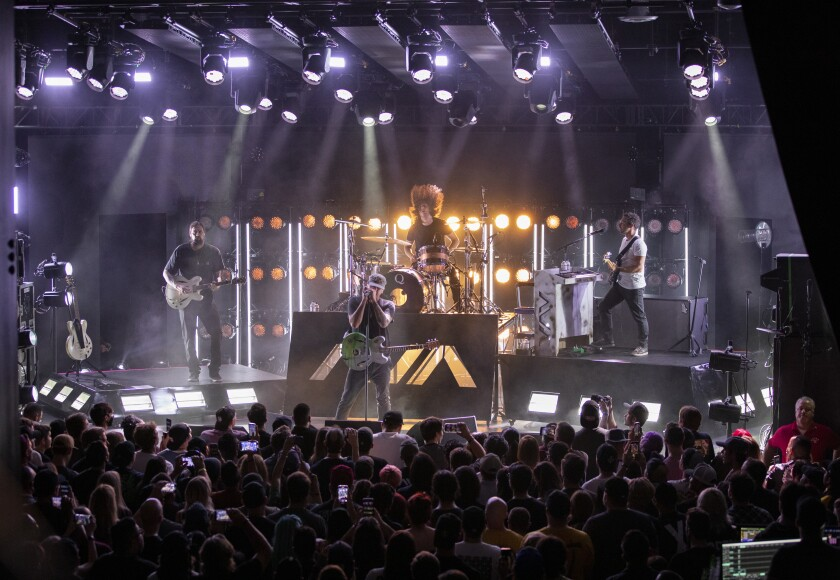 Angels & Airwaves is shown performing July 27 at a private concert at Gnarlywood in Carlsbad.