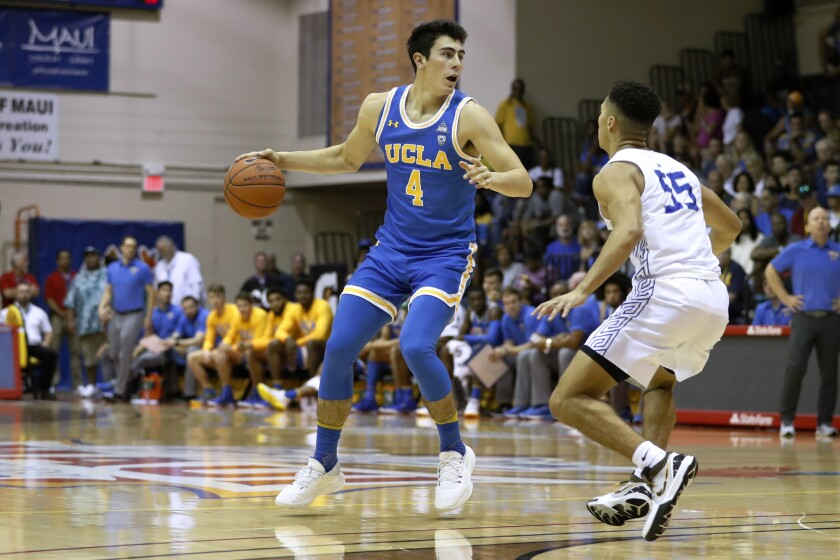 UUCLA guard Jaime Jaquez Jr. sets up the offense while defended by Chaminade guard Isaac Amaral-Artharee during the first half on Nov. 26, 2019, in Lahaina, Hawaii.