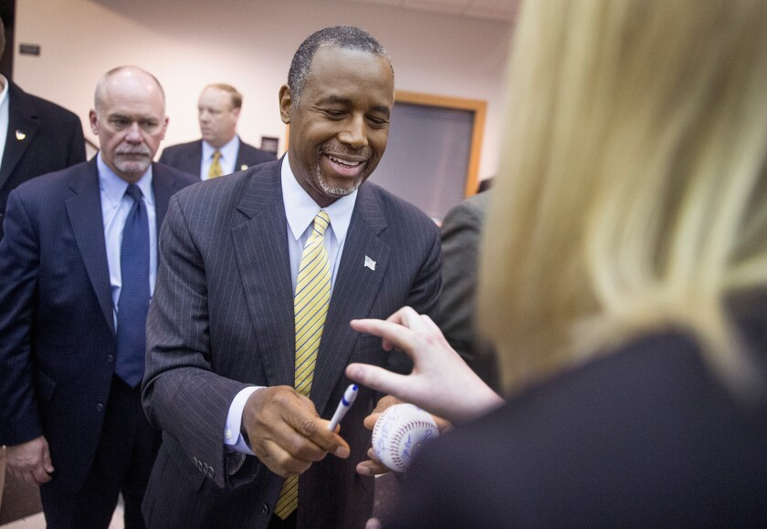 Republican presidential candidate Ben Carson greets guests at a barbecue over the weekend in Wilton, Iowa.