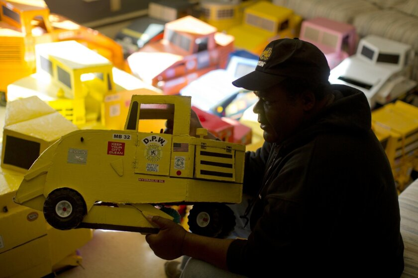 McKinley Page displays a model street sweeper he made, at his home Thursday, Oct. 24, 2013, in Bethlehem, Pa. Ever since age 4, Page has been mesmerized by street sweepers and now spends his days hand-making miniature models after the machines in dozens of New Jersey towns and writing fan letters t